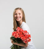 Smiling attractive girl with roses bouquet Royalty Free Stock Images