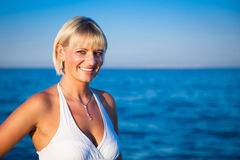 Smiling attractive girl by the sea Royalty Free Stock Images