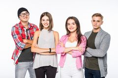 Smiling attractive group of young people standing with crossed arms, against white background. Smiling group of young people standing with crossed arms, against Stock Image