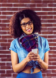 Smiling attractive hipster texting Stock Photos