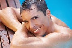Smiling attractive man in swimming pool Stock Photos