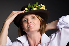 Smiling attractive mature woman in hat Royalty Free Stock Image