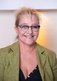 Smiling attractive middle-aged woman with glasses Stock Images