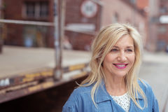 Smiling attractive middle-aged woman Stock Photos