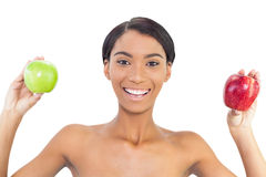 Smiling attractive model holding apples in both hands Stock Photography
