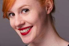 Smiling attractive redhead Royalty Free Stock Images