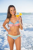 Smiling attractive woman in bikini holding cocktail Royalty Free Stock Image