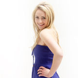 Smiling attractive woman in blue dress Royalty Free Stock Photography