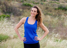 Smiling attractive  woman with blue tank top Royalty Free Stock Photo