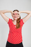 Smiling attractive woman through finger goggles Royalty Free Stock Image
