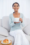 Smiling attractive woman having a breakfast Royalty Free Stock Photography