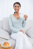 Smiling attractive woman holding cup of coffee Stock Images