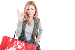 Smiling attractive woman holding shopping bags Stock Photography