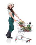 Smiling Attractive Woman Holding Shopping Cart Royalty Free Stock Photo