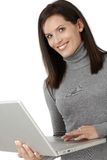 Smiling attractive woman with laptop Stock Photography