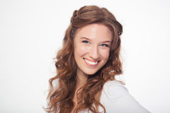 Smiling attractive woman looking at camera Royalty Free Stock Images
