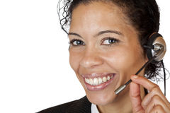 Smiling attractive woman makes with headset a call Stock Photo