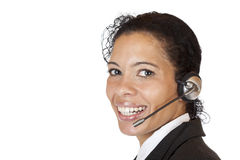 Smiling attractive woman makes with headset a call Stock Image