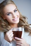 Smiling attractive woman with a mug of coffee Royalty Free Stock Photo