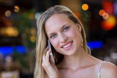 Smiling attractive woman phoning with smartphone Stock Photo