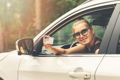 Smiling Attractive Woman Showing Her Driver License Stock Images