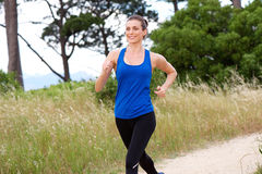 Smiling attractive woman speed walking. Portrait of smiling attractive woman speed walking royalty free stock images