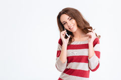 Smiling attractive woman talking on the phone Royalty Free Stock Images