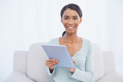 Smiling attractive woman using her digital tablet Stock Image