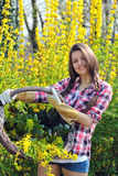 Smiling attractive woman with wicker basket Stock Photography