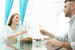 Beautiful couple having romantic dinner stock photos