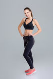 Smiling attractive young fitness woman standing and posing Royalty Free Stock Photography