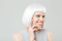 Smiling attractive young woman talking on cell phone Royalty Free Stock Photography