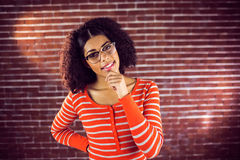 Smiling attractive young woman thinking Royalty Free Stock Image