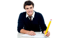 Smiling attractive youngster kid studying. Isolated over white background Royalty Free Stock Photos