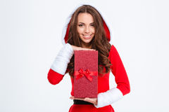 Smiling attractivewoman in santa claus costume posing with present Royalty Free Stock Images