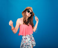 Smiling attrative young woman listening to music from cell phone Royalty Free Stock Images