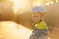 Smiling aussie boy wearing bicycle helmet. Smiling aussie boy wearing helmet and riding his bicycle a day in Glenelg, South Australia Stock Photo