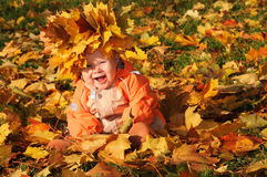 Smiling Autumn Baby Stock Images