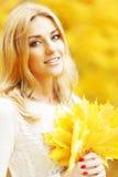 Smiling autumn woman royalty free stock image