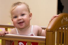 Smiling baby 1. Smiling baby in the baby bed Stock Image