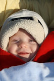 Smiling baby. Adorable smiling baby with sunlight on his face Stock Photography