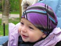 Smiling baby. Cute baby boy wearing violet bandana Stock Photo
