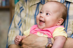 Smiling baby. Baby girl smile on father hands Stock Images