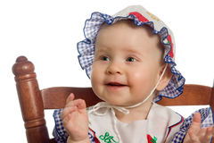 Smiling baby. Smiling baby on woden chair Royalty Free Stock Photo