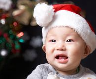 Smiling baby. In a santa hat Royalty Free Stock Photos