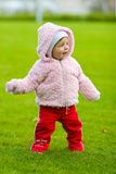 Smiling Baby. Picture of a smiling baby girl on a green grass Royalty Free Stock Photography