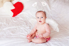 Smiling baby Angel with Wings Stock Images