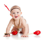 Smiling baby as Indian boy with musical toy Royalty Free Stock Image