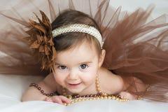 Smiling baby ballerina in brown tutu Royalty Free Stock Image