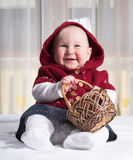 Smiling baby with basket stock photo